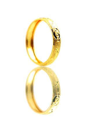 A golden ring standing on white background. photo