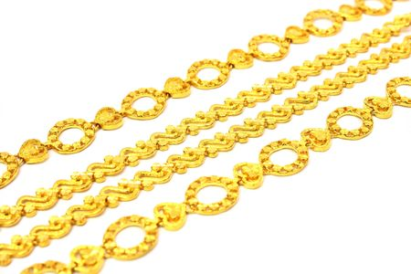 A few golden chains align in oblique angle.