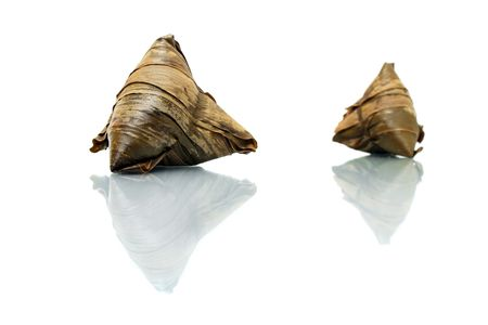Two rice dumplings (Chinese traditional food) isolated on white background. photo