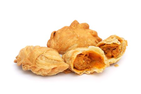 Three curry puffs isolated on white background.