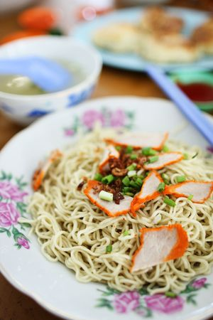 Closeup of Kampua mee (Sarawak Chinese noodles) with roasted pork meat. Stock Photo