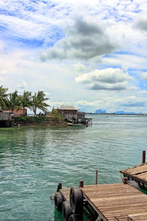Landscape view of jetty on cloudy sunny day. photo