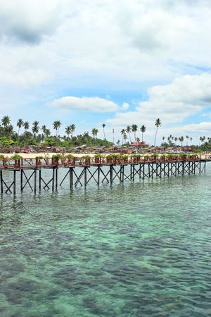 Wooden bridge built above water at Mabul Island. photo