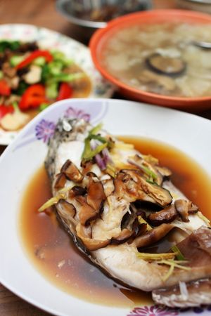 steamed: Close up of mushroom fish with other dishes.