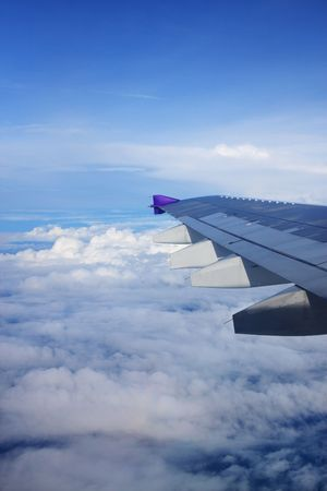 Aerial view of cloudy sky from aircraft windows. Stock Photo - 5801827