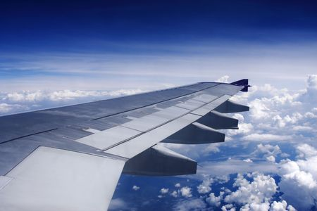 Aerial view of cloudy sky from aircraft windows. Stock Photo - 5801825