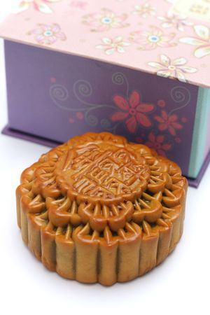 Close up of a mooncake isolated over white background. (The chinese words indicates the type of mooncake, not the brand) photo