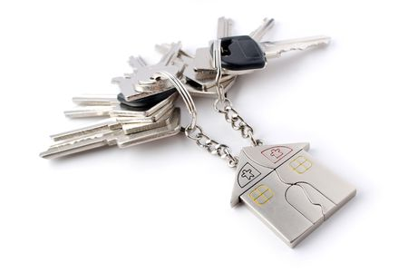 A bunch of keys with keychain isolated on white background. photo