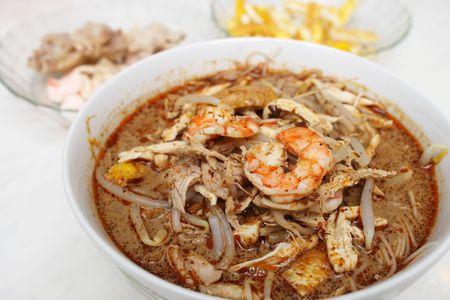 Close up of Sarawak Laksa (Sarawak Chinese Noodles) with prawn.