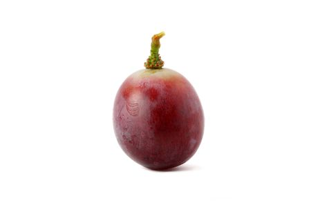 Close up of a red grape isolated on white background.
