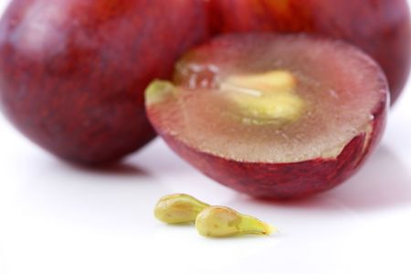 fullness: An half and fullness grapes with seeds isolated over white background.