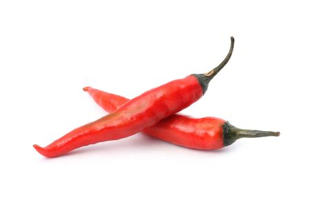 Two red hot chili peppers isolated on white background.