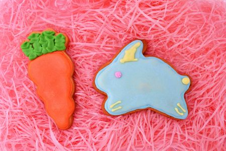 Close up of easter cookies on pink ribbons as background. photo