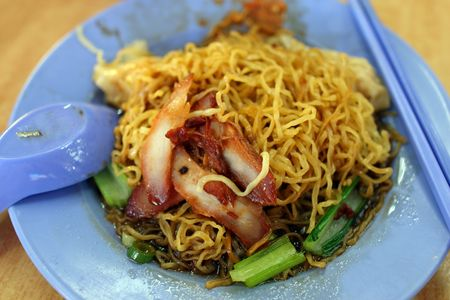 Closeup of wantan noodle (chinese noodles) with roasted pork meat.