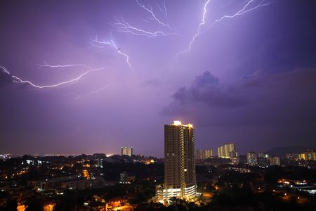 View of a lightning over city at night. Stock Photo