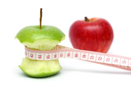 bitten: Close up of red and green apple with measuring tape isolated on white background.