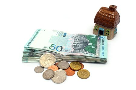 Malaysia banknote and mixed coins with a house. Standard-Bild