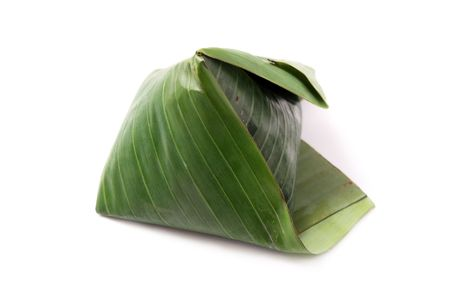 A pack of nasi lemak (Malaysia National Dish) isolated on white background.