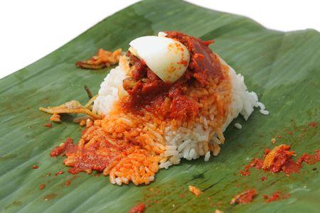 Close up of nasi lemak (Malaysia National Dish) isolated on white background.