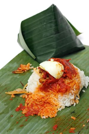 Close up of nasi lemak (Malaysia National Dish) isolated on white background. photo