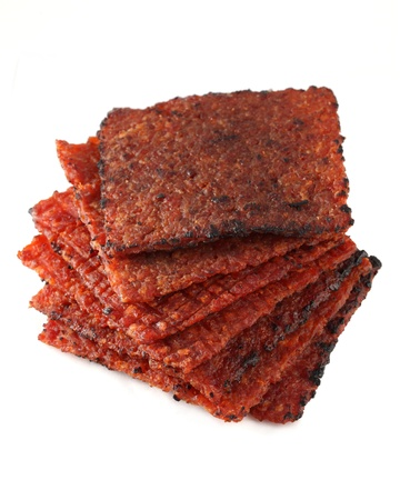 Close up of barbecue meat stacked and isolated over white background. Stock Photo