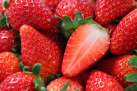 Close up of many Korea strawberry stacked together.