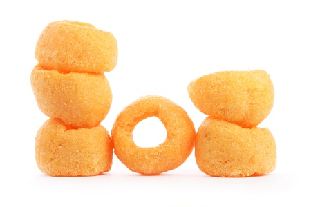 Close up of many cheesy rings isolated on white background. photo
