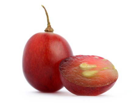 Close up of red grape isolated on white background. Banque d'images