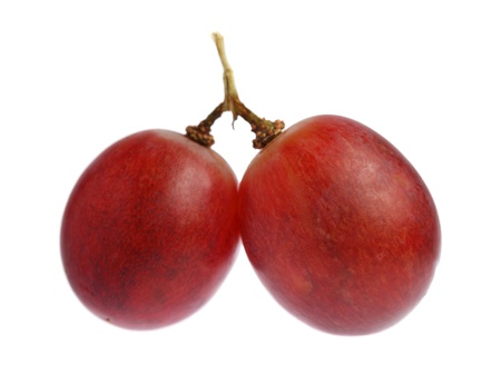A string of two grapes isolated on white background. Stock Photo