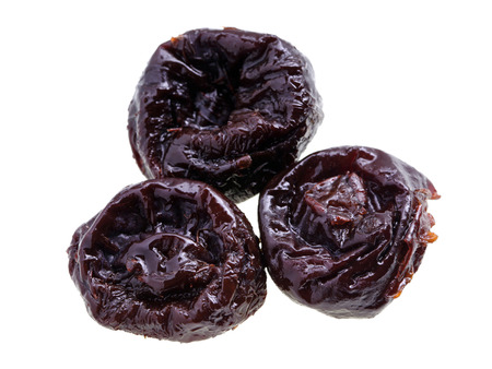 pitted: Close up of pitted prunes
