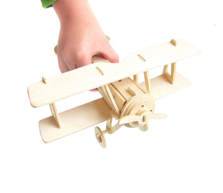 wooden model plane on a white background Stock Photo