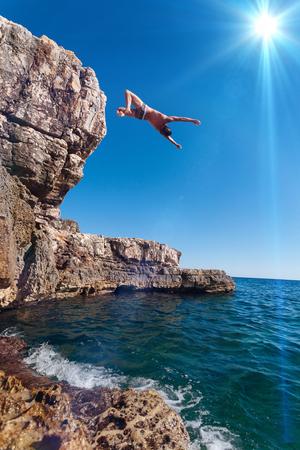 Jump from the cliff to Croatia, on Krk island Reklamní fotografie