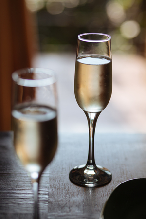 Flutes filled with sparkling prosecco, in a restaurant in Conegliano Stock Photo