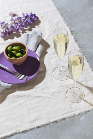 Aperitif with prosecco calix and olives on a table Stockfoto