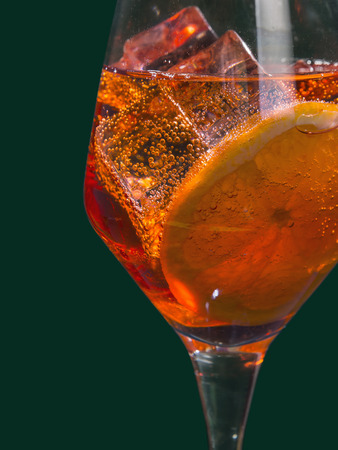 Venetian Spritz, an IBA cocktail with Prosecco or white sparkling wine, bitters, soda, ice and a slice of orange, in a calix on a table, pop graphic style Stok Fotoğraf