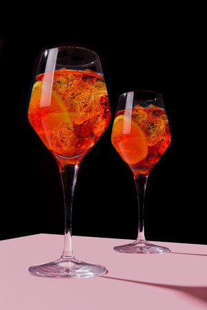 Venetian Spritz, an IBA cocktail with Prosecco or white sparkling wine, bitters, soda, ice and a slice of orange, in a calix on a table, pop graphic style Stock fotó
