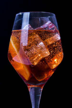Venetian Spritz, an IBA cocktail with Prosecco or white sparkling wine, bitters, soda, ice and a slice of orange, in a calix on a table, pop graphic style Stock Photo