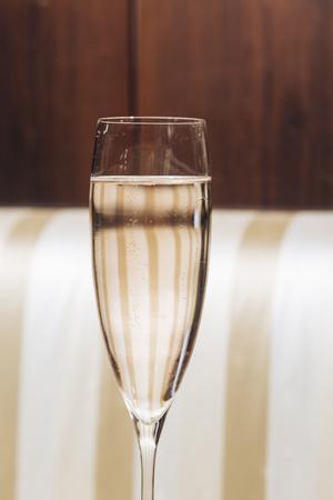 A flute with Prosecco sparkling wine in an elegant restaurant in Valdobbiadene Banco de Imagens