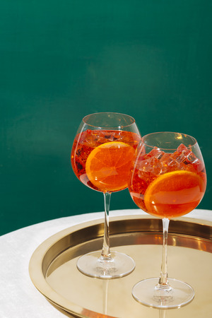 Spritz, an aperitif cocktail with sparkling Prosecco, bitter, seltz and orange slice, on a table in pop contemporary style Reklamní fotografie
