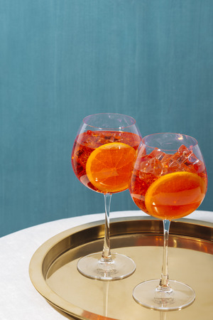 Spritz, a cocktail with sparkling Prosecco, bitter, seltz and orange slice, on a table in pop contemporary style Reklamní fotografie