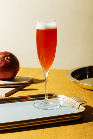 Tintoretto, an italian cocktail with 23 Prosecco (or Champagne) and 13 pomegranate juice, served in a flute. Pop contemporary style