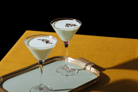 Grasshopper cocktail, an old classic from New Orleans, with green creme de menthe. white creme de cacao and light cream (or single cream in UK)