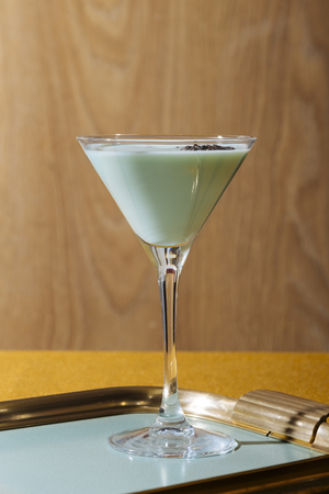 Grasshopper cocktail, an old classic from New Orleans, with green creme de menthe. white creme de cacao and light cream (or single cream in UK, half and half in USA) Фото со стока