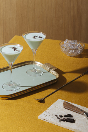 Grasshopper cocktail, an old classic from New Orleans, with green creme de menthe. white creme de cacao and light cream (or single cream in UK, half and half in USA) Stock fotó