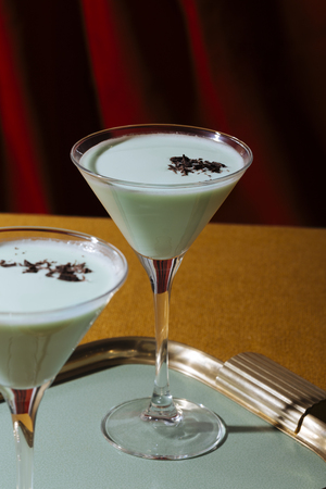 Grasshopper cocktail, an old classic from New Orleans, with green creme de menthe. white creme de cacao and light cream (or single cream in UK, half and half in USA) Reklamní fotografie