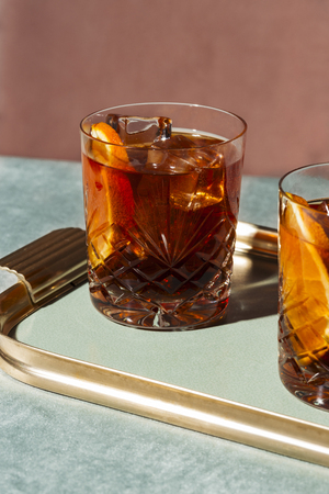Negroni, an Iba cocktail, with 13 gin, 13 bitter, 13 vermut, in luxury pop style, rich and colorful.