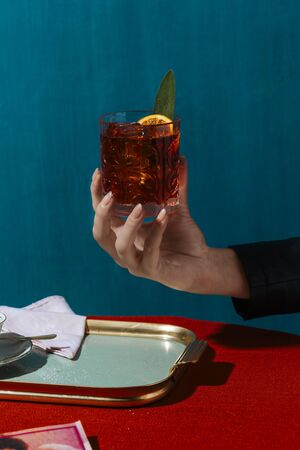Negroni is an alcoholic aperitif cocktail with a typical light red color, based on vermouth, bitters and gin. Colorful and rich contemporary style.