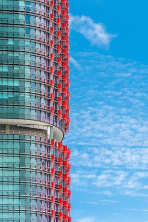 Close up of the International Towers in Sydney with the red flaps against the blue sky