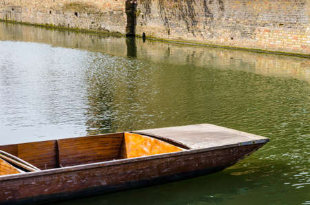 Close up of a single punt on river Cam in Cambridge, United Kingdom