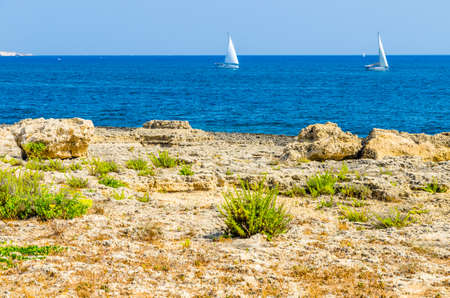 View of Marine Protected area of Plemmirio in a sunny day with blue sky, Syracuse, Sicily